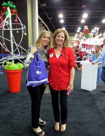 Junior League President Cristi Reiger and Mistletoe Market Chairman Amy Parrish welcome guests to the MM Preview Party. (Photo by Helen Ford Wallace).