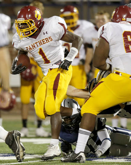 Putnam City North&#039;s Tae Moore runs for a touchdown against Edmond North during a high school football game at Wantland Stadium in Edmond, Okla., Friday, September 21, 2012. Photo by Bryan Terry, The Oklahoman
