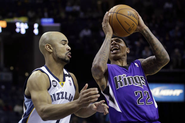 Sacramento Kings' Isaiah Thomas (22) shoots over Memphis Grizzlies' Jerryd Bayless, left, during the first half of an NBA basketball game in Memphis, Tenn., Friday, Jan. 18, 2013. (AP Photo/Danny Johnston)