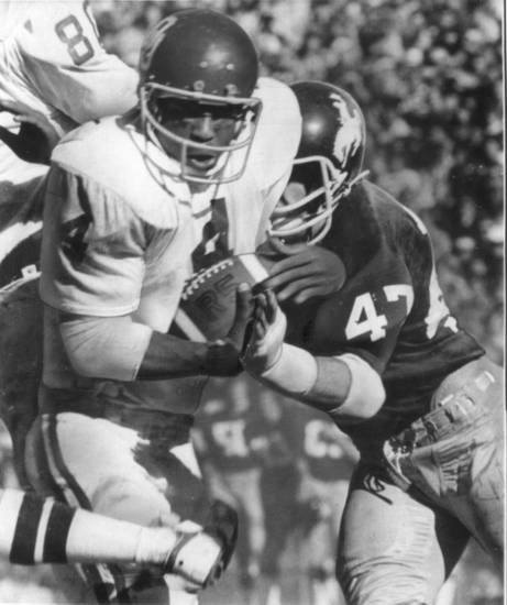 COLLEGE FOOTBALL: 1976 Fiesta Bowl - Wyoming defensive end Dave Clements blindsides OU halfback Elvis Peacock. 12-26-1976