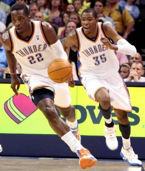 Oklahoma City's Jeff Green (left) and  Kevin  Durant take the ball downcourt against Minnesota during their NBA basketball game at the Ford Center in downtown Oklahoma City on Sunday, April 4, 2010. The Thunder beat the Timberwolves 116-108. Photo by John Clanton