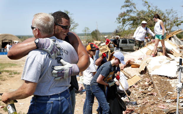 Randy Thomas District 2 Pottawatomie County Board of Commissioners hugs Oklahoma State football player James Castleman after thanking him for helping clear debris ,Wednesday, June 12, 2013, in Bethel Acres, Okla. Photo by Sarah Phipps, The Oklahoman