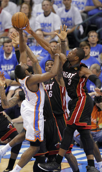 Miami's Dwyane Wade (3) and Miami's LeBron James defend Oklahoma City's James Harden (13) during Game 2 of the NBA Finals between the Oklahoma City Thunder and the Miami Heat at Chesapeake Energy Arena in Oklahoma City, Thursday, June 14, 2012. Photo by Chris Landsberger, The Oklahoman