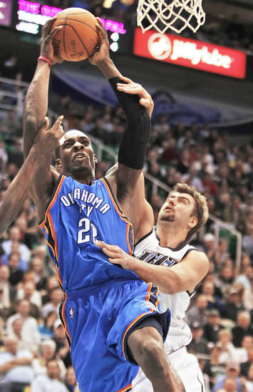 The Thunder&amp;#8217;s Jeff Green, left, is fouled by Utah&amp;#8217;s Mehmet Okur during action on Tuesday night.  AP photo