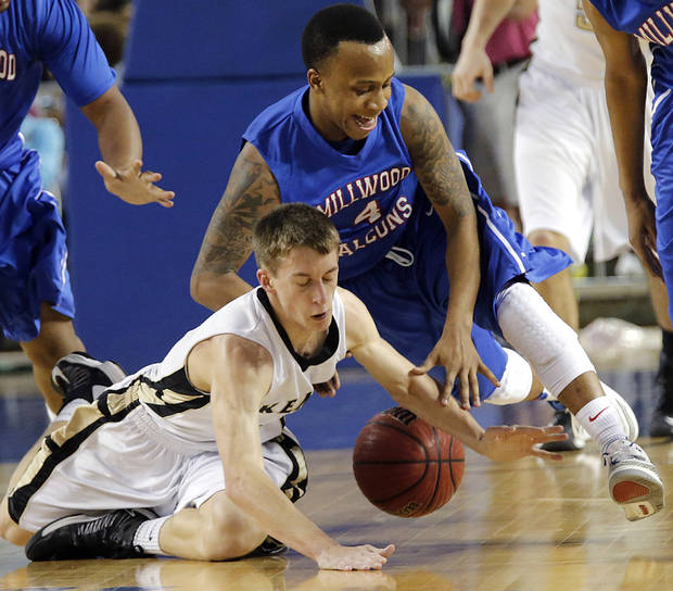 Millwood's Jaylen Edwards (4) and Okemah's John Wingfield (4) battle for a loose ball during the state high school basketball tournament Class 3A boys championship game between Millwood High School and Okemah High School at the State Fair Arena on Saturday, March 9, 2013, in Oklahoma City, Okla. Photo by Chris Landsberger, The Oklahoman