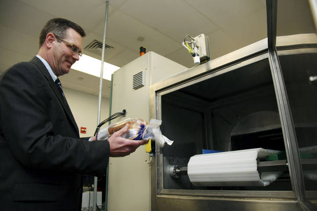 Don Stull, chief executive officer of Microzap, Inc., places a loaf of bread inside a patented microwave that kills mold spores in Lubbock, Texas. AP Photo <strong>John Mone</strong>