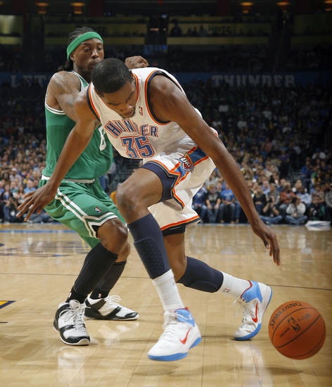 Oklahoma City's Kevin Durant (35) looses the ball as Boston's Marquis Daniels (8) defens during the NBA game between the Oklahoma City Thunder and the Boston Celtics, Sunday, Nov. 7, 2010, at the Oklahoma City Arena. Photo by Sarah Phipps, The Oklahoman