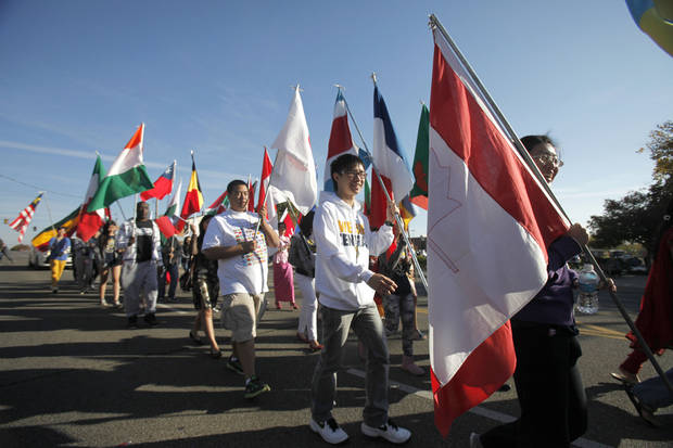 International students display flags of their home countries during the University of Central Oklahoma&#039;s homecoming parade in Edmond, OK, Saturday, November 3, 2012,  By Paul Hellstern, The Oklahoman