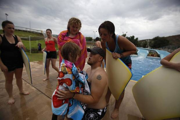 ETHAN MITCHELL / CHILD / CHILDREN / KIDS: James Mitchell, of Marlow, comforts his son, Ethan, 6, after slipping on the concrete at Quartz Mountain Water Slide in Lone Wolf, Okla., Wednesday, June 6, 2012.  Photo by Garett Fisbeck, The Oklahoman