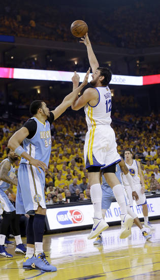 Golden State Warriors' Andrew Bogut shoots over Denver Nuggets' JaVale McGee during the first half of Game 6 in a first-round NBA basketball playoff series in Oakland, Calif., Thursday, May 2, 2013. (AP Photo/Marcio Jose Sanchez)