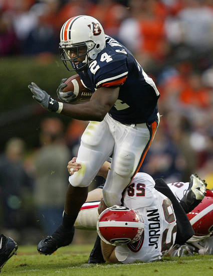 Auburn's Carnell Williams (24) breaks away from Georgia's Brian Jordan as he returns a punt in the third quarter in Auburn, Ala. Saturday, Nov. 13, 2004. Auburn won 24-6. (AP Photo/John Bazemore)
