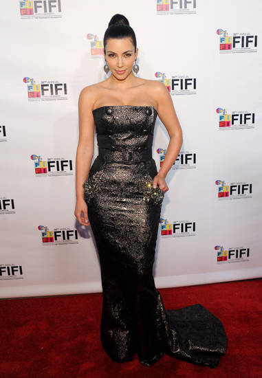 Television personality Kim Kardashian attends the FiFi Fragrance Foundation Awards on Thursday, June 10, 2010 in New York. (AP Photo/Evan Agostini) ORG XMIT: NYEA105