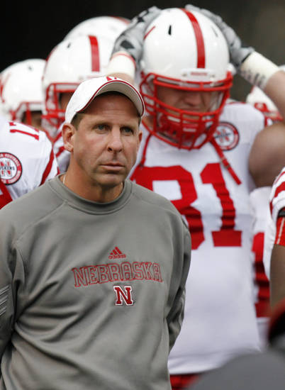 Nebraska head coach Bo Pelini stands with his team before the college football game between the Oklahoma State Cowboys (OSU) and the Nebraska Huskers (NU) at Boone Pickens Stadium in Stillwater, Okla., Saturday, Oct. 23, 2010. Photo by Nate Billings, The Oklahoman
