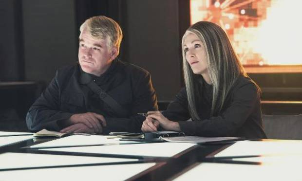 """The late Philip Seymour Hoffman and Julianne Moore appear in a scene from """"The Hunger Games: Mockingjay - Part 1."""" Photo provided"""