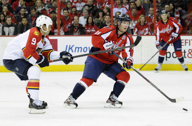 Washington Capitals center Nicklas Backstrom (19), of Sweden, passes the puck against Florida Panthers center Stephen Weiss (9) during the second period of an NHL hockey game, Saturday, Feb. 9, 2013, in Washington. (AP Photo/Nick Wass)