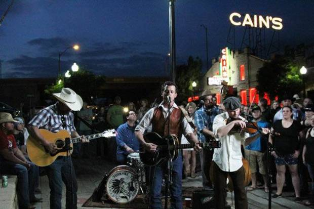 "Turnpike Troubadours perform in front of a hometown crowd outside Cain's Ballroom in Tulsa for CMT's ""Concrete Country."" Photo Credit: Jimmy Corn/CMT"