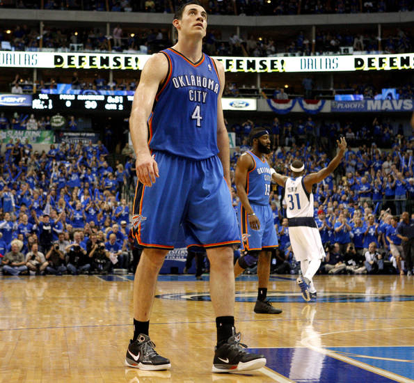Oklahoma City's Nick Collison (4) walks back to the bench during game 1 of the Western Conference Finals in the NBA basketball playoffs between the Dallas Mavericks and the Oklahoma City Thunder at American Airlines Center in Dallas, Tuesday, May 17, 2011. Photo by Bryan Terry, The Oklahoman