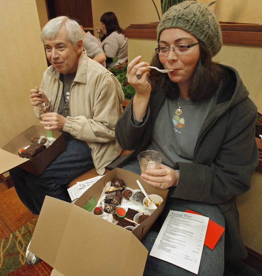 Father and daughter chocolate lovers Tom Steele and Emilie Giustozzi enjoy their selections at the 30th annual Chocolate Festival benefiting the Firehouse Art Center on Saturday, Jan. 28, 2012, in Norman, Okla.   Photo by Steve Sisney, The Oklahoman