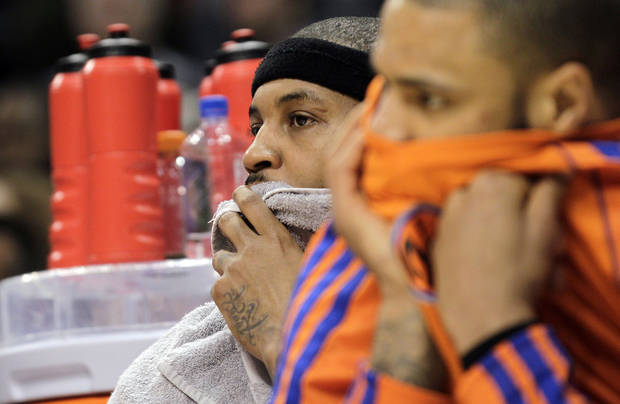New York Knicks forward Carmelo Anthony, left, and center Tyson Chandler watch from the bench during the fourth quarter of an NBA basketball game against the Indiana Pacers in Indianapolis, Wednesday, Feb. 20, 2013. The Pacers crushed the Knicks 125-91. (AP Photo/AJ Mast)