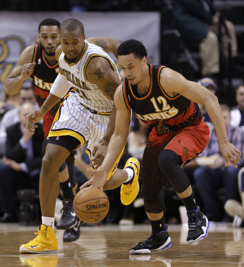 Atlanta Hawks guard John Jenkins, right, steals the ball from Indiana Pacers forward David West during the first half of an NBA basketball game in Indianapolis, Tuesday, Feb. 5, 2013. (AP Photo/Michael Conroy)