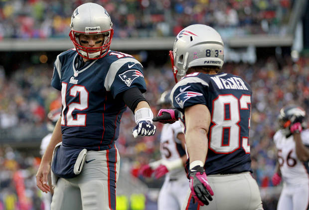 New England Patriots quarterback Tom Brady (12) fist-bumps wide receiver Wes Welker (83) after they connected for a touchdown against the Denver Broncos in the first quarter of an NFL football game, Sunday, Oct. 7, 2012, in Foxborough, Mass. (AP Photo/Steven Senne)