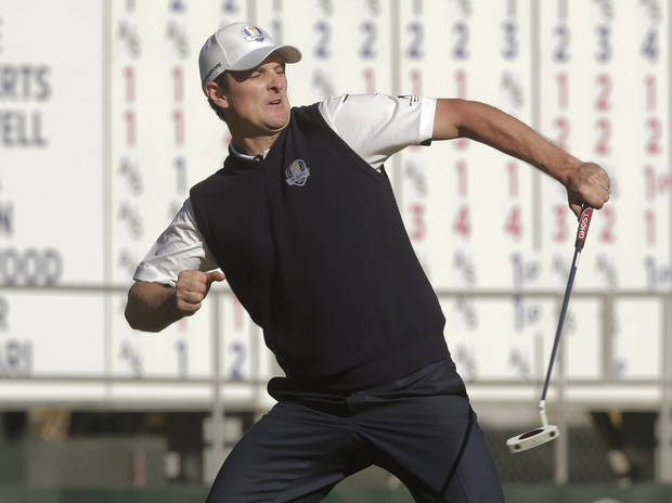 Europe's Justin Rose reacts after defeating USA's Phil Mickelson on the 18th hole during a singles match at the Ryder Cup PGA golf tournament Sunday, Sept. 30, 2012, at the Medinah Country Club in Medinah, Ill. (AP Photo/Charlie Riedel)  ORG XMIT: PGA163