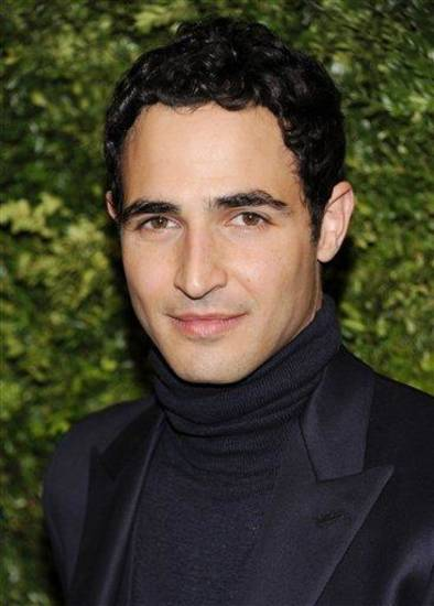 "FILE - In this Nov. 14, 2011 file photo, designer Zac Posen attends the CFDA / Vogue Fashion Fund Awards in New York. Posen is the new featured judge for the new season of ""Project Runway,"" filling the chair that Michael Kors had sat in for the show's first 10 seasons. The new season starts Jan. 24, 2013. (AP Photo/Evan Agostini, File)"