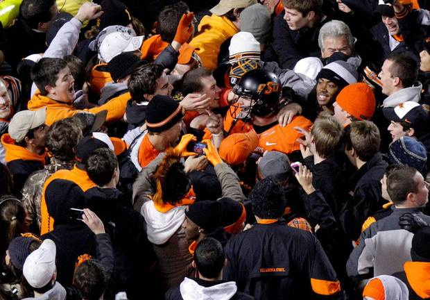 Oklahoma State's Brandon Weeden (3) celebrates with fans following the Bedlam college football game between the Oklahoma State University Cowboys and the University of Oklahoma Sooners at Boone Pickens Stadium in Stillwater, Okla., Saturday, Dec. 3, 2011. Photo by Bryan Terry, The Oklahoman