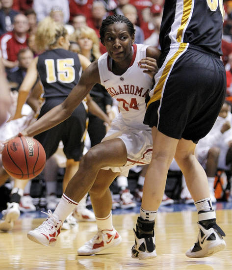 OU's Sharane Campbell (25) dribbles around Missouri's Christine Flores (50) during the Big 12 tournament women's college basketball game between the University of Oklahoma Sooners and the University of Missouri Tigers at Municipal Auditorium in Kansas City, Mo., Thursday, March 8, 2012. OU won, 70-59. Photo by Nate Billings, The Oklahoman