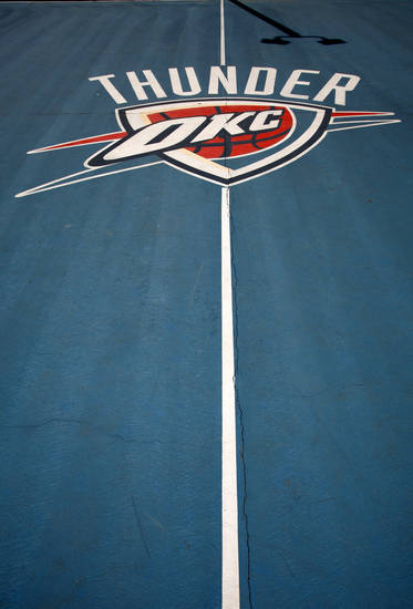 A Thunder charity group resurfaces the Oklahoma City Police Athletic League�s basketball court at Draper Park two years ago. PHOTO BY STEVE GOOCH, THE OKLAHOMAN