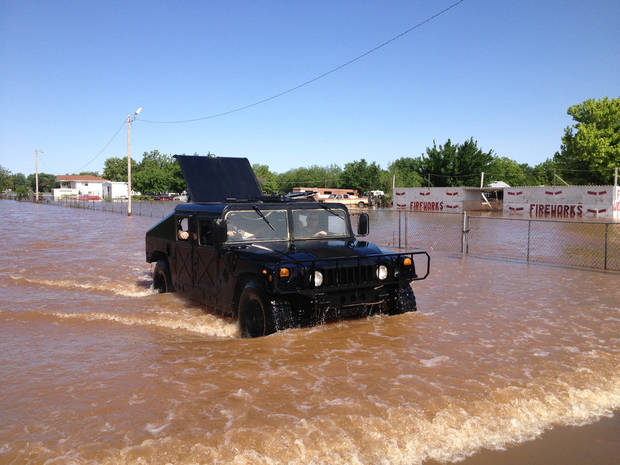 An Oklahoma County Sheriffs Dept. Humvee brings out residents from a flooded mobile home park off of air depot between 10th & 23rd. Photo by Paul Hellstern