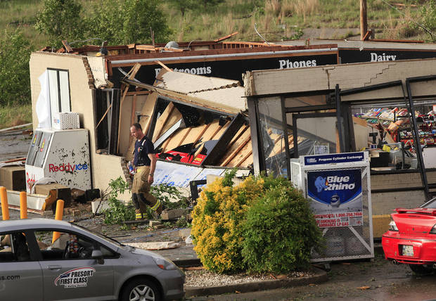 A firefighter walks out of the Love's store after a tornado ripped the building's roof off, causing its walls to collapse inward at the store,  south of Interstate 40 at Choctaw Rd., Monday evening, May 10, 2010.   Photo by Jim Beckel, The Oklahoman