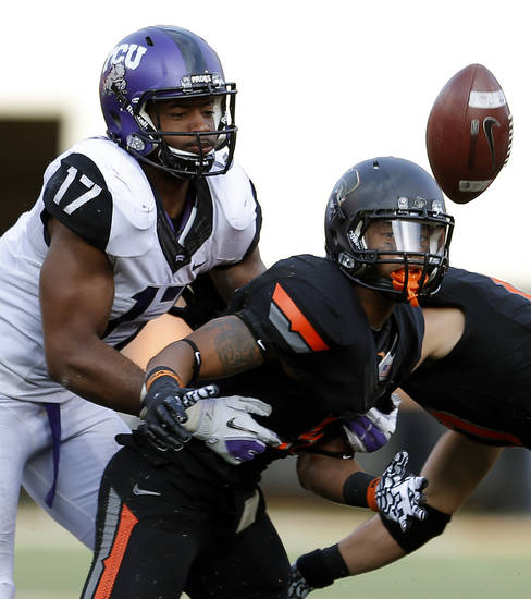 TCU's Sam Carter (17) breaks up a pass intended for Oklahoma State's Josh Stewart (5) during a college football game between Oklahoma State University (OSU) and Texas Christian University (TCU) at Boone Pickens Stadium in Stillwater, Okla., Saturday, Oct. 27, 2012. Photo by Sarah Phipps, The Oklahoman
