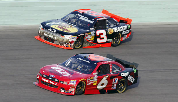   Ricky Stenhouse (6) and Austin Dillon (3) race during the NASCAR Nationwide Series auto race at Homestead-Miami Speedway, Saturday, Nov. 17, 2012, in Homestead, Fla. (AP Photo/Alan Diaz)  