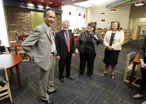 French Consul General Frederic Bontems, foreground, visits with students and faculty at Ronald Reagan Elementary School in Norman. With him are, from left, Grant Moak, French consulate of Oklahoma; Janet Gorton, Norman Public Schools world language coordinator; and Principal Carol Burton. PHOTO BY STEVE SISNEY, THE OKLAHOMAN <strong>STEVE SISNEY</strong>