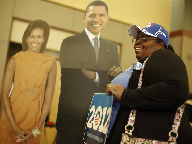 Wannie Debouse, of Midwest City, has her photo taken with cardboard cutouts of Barack and Michelle Obama during the Oklahoma Democratic Party watch gathering at the Reed Center in Midwest City, Tuesday, Nov. 6, 2012.  Photo by Garett Fisbeck, The Oklahoman