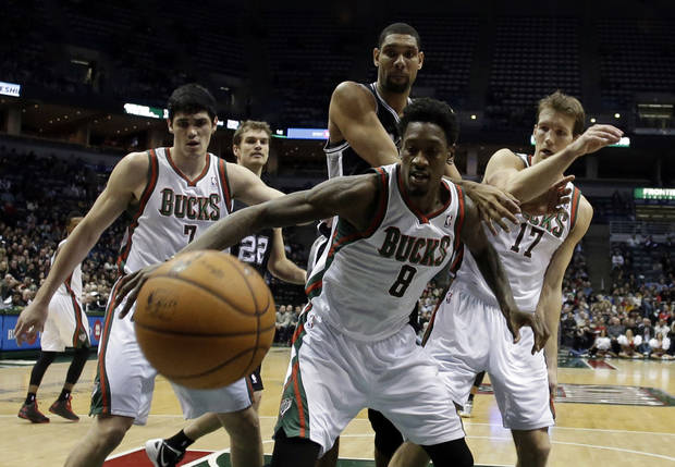 Milwaukee Bucks' Ersan Ilyasova (7), Larry Sanders (8) and Mike Dunleavy (17) go after a loose ball against San Antonio Spurs' Tim Duncan during the second half of an NBA basketball game on Wednesday, Jan. 2, 2013, in Milwaukee. (AP Photo/Morry Gash)