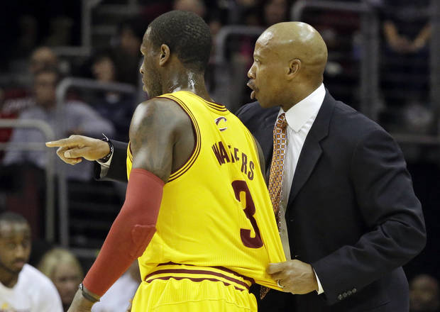 Cleveland Cavaliers head coach Byron Scott, right, instructs Dion Waiters (3) in the first quarter of an NBA basketball game against the Dallas Mavericks, Saturday, Nov. 17, 2012, in Cleveland. (AP Photo/Mark Duncan)