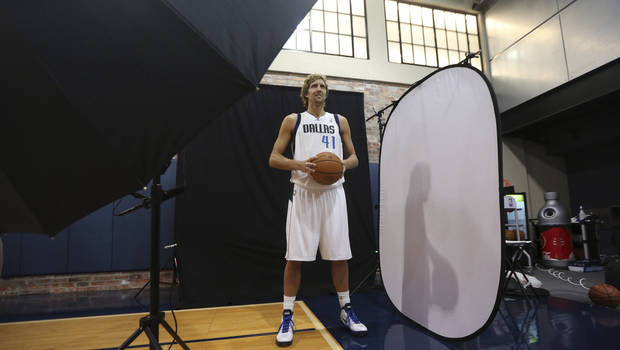   **CORRECTS DAY TO FRIDAY** Dallas Mavericks Dirk Nowitzki of Germany posses for a photo during team&#039;s media day Friday Sept. 28, 2012, in Dallas. Nowitzki again has a lot of new teammates with the Mavericks. For the second year in a row, this time after being swept out of the playoffs instead of winning the NBA title, the Mavs have drastically altered their roster. (AP Photo/LM Otero)  