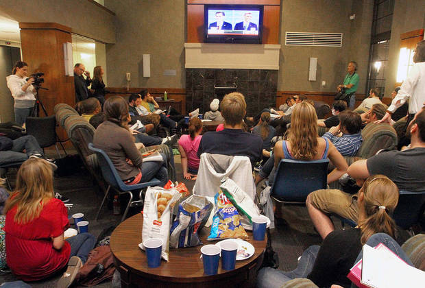   Augustana College students in Rock Island, Ill., bring chips and snacks to the Great Hall of Emmy Carlsson, in Evald Hall as they watch the first presidential debate between President Obama and Gov. Mitt Romney, Wednesday, Oct. 3, 2012 in Rock Island, Ill. (AP Photo/The Quad City Times, John Schultz)  