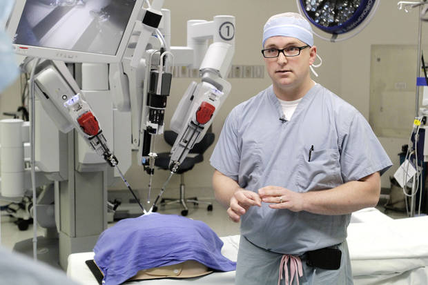 Dr. Brandon Kilgore talks about a new surgical robot which is being used to perform gall bladder surgery at the OU Medical Center in Edmond, OK, Monday, March 19, 2012,  The device is controlled remotely from a console. By Paul Hellstern, The Oklahoman