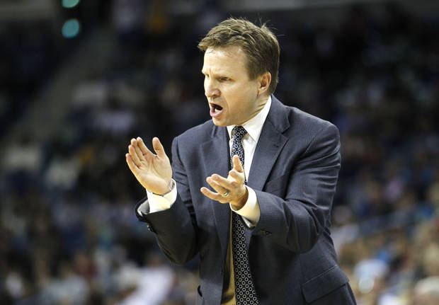 Oklahoma City Thunder head coach Scott Brooks calls out to his team in the second half of an NBA basketball game against the New Orleans Hornets in New Orleans, Friday, Dec. 10, 2010. The Thunder won 97-92. (AP Photo/Gerald Herbert) ORG XMIT: LAGH113