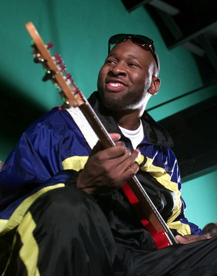 Former OU basketball star Wayman Tisdale goes through a sound check with his band at Bricktown Birdies.