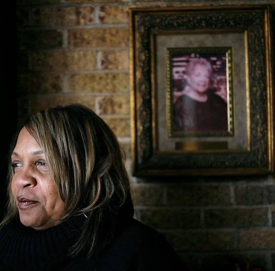 Jacqueline Parks, executive director at Metropolitan Better Living Center, poses under a picture of her mother Juanita Davis on Wednesday, Nov. 18, 2009. Juanita Davis started the Metropolitan Better Living Center.  By John Clanton, The Oklahoman