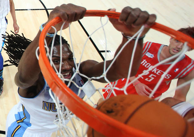 Team Chuck's Kenneth Faried, of the Denver Nuggets, dunks as Team Shaq's Chandler Parsons, of the Houston Rockets, looks on during the first half of the Rising Stars Challenge basketball game at NBA All-Star Weekend, Friday, Feb. 15, 2013, in Houston. (AP Photo/Ronald Martinez, Pool)