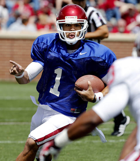 Kendal Thompson (1) directs his receivers as he scrambles on a play during the annual Spring Football Game at Gaylord Family-Oklahoma Memorial Stadium in Norman, Okla., on Saturday, April 13, 2013. Photo by Steve Sisney, The Oklahoman