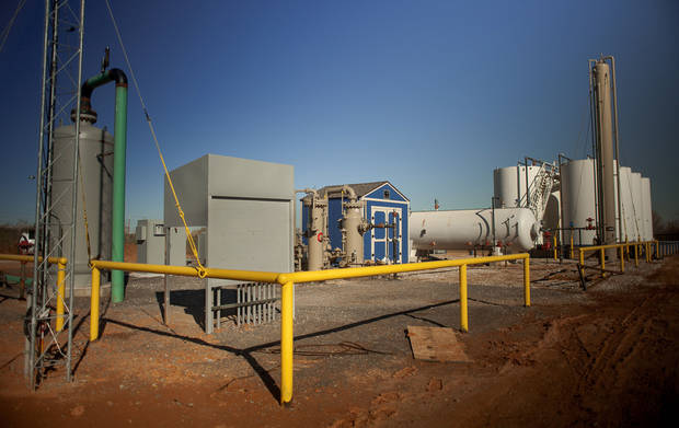Devon Energy Corp. is using vapor recovery units, center, to capture emissions at this well pad near Geary. The captured gas can be sold rather than burned or vented into the air. Photo provided <strong></strong>