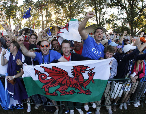 European fans celebrates after winning the Ryder Cup PGA golf tournament Sunday, Sept. 30, 2012, at the Medinah Country Club in Medinah, Ill. (AP Photo/Charles Rex Arbogast)  ORG XMIT: PGA220
