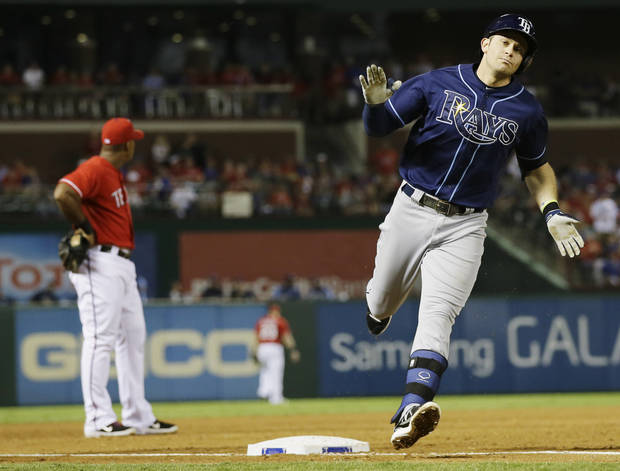 Tampa Bay Rays' Evan Longoria rounds the bases on his two-run home run against the Texas Rangers during the third inning of an American League wild-card tiebreaker baseball game Monday, Sept. 30, 2013, in Arlington, Texas. Texas Rangers' Adrian Beltre is at rear. (AP Photo/Tony Gutierrez)