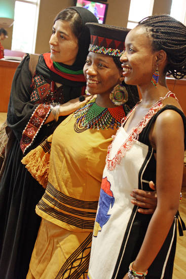 Fulbright scholars attend a cultural dinner at the University of Oklahoma. From left are Shugofa Dastgeer, from Afghanistan, and Mandisa Haarhoff and Wanda Sondiyazi, both of South Africa.  Photo by Ashley R. West, for The Oklahoman